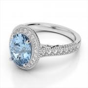 Diamond & 9x7mm Gemstone Halo Ring